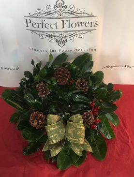 Holly Wreath with green festive bow and natural pine cones