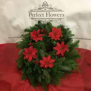 spruce-wreath-with-artificial-poinsettia-flowers