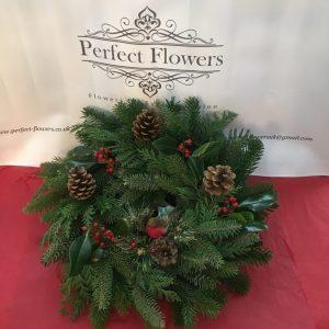 spruce-wreath-pine-cones-robin