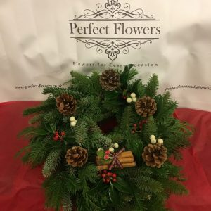 spruce-wreath-with-pine-cones-cinnamon-sticks
