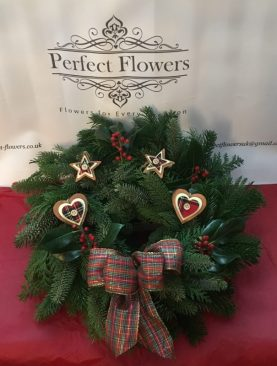 Spruce Wreath with tartan decorations and bow